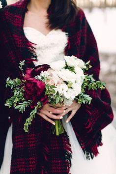 Lovely hand-tied rose and peony bouquet. Cozy winter wedding inspirations. Elegantly paired with a warm afghan blanket to perfect the cozy winter look.   Toronto Wedding Planner Photocredit to Danfredo Photography & Film Whim Event Coordination and Design www.eventsbywhim.ca