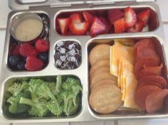 Crackers, cheese & pepperoni; broccoli & dip; raspberries & blueberries; strawberries; Snocaps