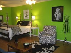 Digging the green wall w the black & white, love this bedroom!