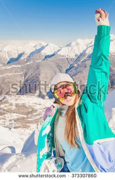 Image of achieve female snowboarder on the background of high snow-capped Alps, Swiss. Healthy lifestyle. Happy and achievement