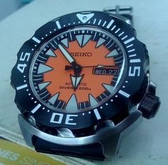 """A great looking Seiko SRP315K Orange Monster out of Singapore.  I'm really gaga about the Seiko """"Monsters"""", though I prefer the older styles. However, this one really does something for me.  Omega, Sinn, IWC, Blancpain are all great for serious, thoughtful purchases, but for on the spot impluse buying, you can't go wrong with great-looking, well-built Seikos! And, their vintage divers are some of the most incredibly cool watches to be had at any price."""