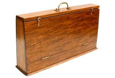 This is a nice and unusual vintage American surveyor's field box. It was used to carry instruments and papers on jobs out of the office. The color and patina of the wood is beautiful. The top opens on brass hinges and the handle, lock and closures are also brass.