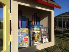 Adding new books to our Little Free Library!