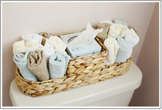 Bathroom Decorating Ideas | Find a narrow basket to place on the back of the toilet, and fill it with bathroom accessories for added elegance.