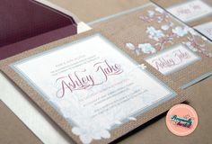 'Burlap Beauty' wedding invitations design featuring a burlap fabric print with a floral pattern in dusty blue and plum. Available for purchase at www.personallyinvited.com.au