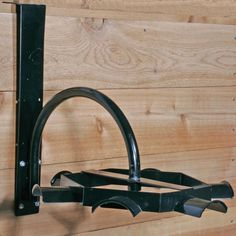 We love our Easy-Up® Carousel Tack Rack. Keep your tack room organized with these six arched and lipped bridle hangers on a compact turning wheel!