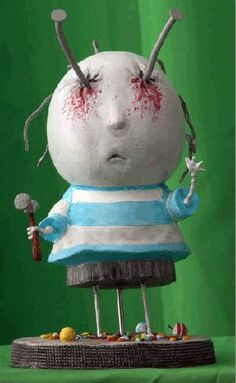 doll with nails in eyes