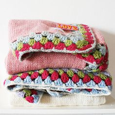 crochet blankets or small material squares then crochet them all together. half quilt half crochet blanket