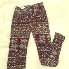 🆕 Soft Tribal Print Leggings New with tags: very soft and stretchy tribal print leggings. Labeled one size fits all. 92% Polyester, 8% Spandex. Blues, pinks, white. Hot Kiss Pants Leggings