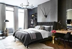 Grey masculine bedroom with antler wall decor
