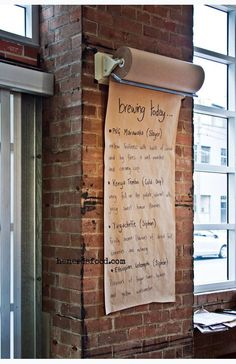Butcher's paper roll coffee menu. Looks great against the exposed brick.