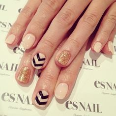 nude gold nails with black chevron accents
