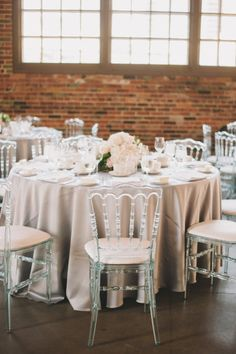 industrial space with elegant tablescapes Photography by Mango Studios / http://mangostudios.com, Floral Design by My Elegant Baskets / http://myelegantbaskets.com/
