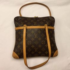 Louis Vuitton Coussin GM monogram bag MAKE ANOFFER Authentic , LV monogrammed Coussin GM pretty , 10.5x10.5 , felt material inside , clean , no rips or stains , top of handles are honey patina , just beautiful, wear on shoulder too, felt inside in big and small compartment are intact , usable , corners have some markings from normal use ,  date code is SD0074 SEE XTRA pictures in another listing, No TRADES ; REASONABLE SERIOUS OFFERS ENTERTAINED  Louis Vuitton Bags