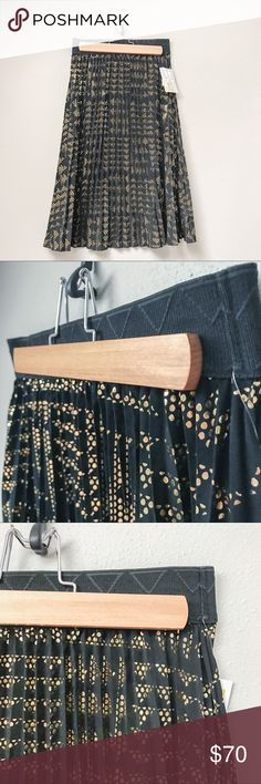 Vintage LuLaRoe Elegant Jill Skirt LuLaRoe's Jill skirt features an accordion-pleated skirt with an exposed elastic waistband. This Jill is black with metallic gold dots creating an allover geometric pattern. This Jill skirt was released in the 2016 Elegant Collection; vintage LuLaRoe and extremely rare.  ✅Bundle & Save 🚫Trades 🚫Off-Posh 🚫Modeling  💞Shop with ease; I'm a Posh Ambassador.💞 LuLaRoe Skirts