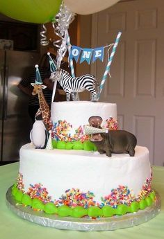 First birthday cake: Party Animal theme with plastic Schleich animals with party hats! Sams club cake included sprinkles and incing. Just add animals and banner!!