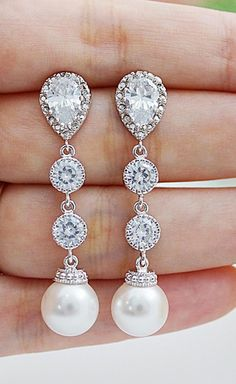 Gorgeous drop earrings for the bride in pear shaped crystals with pearl accents