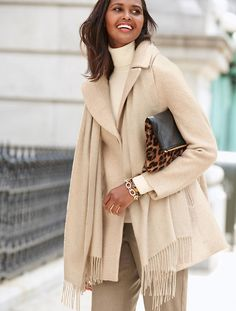 A wider notched collar gives a stylish coat a demure look.