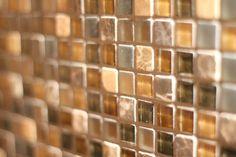 Glass mosaic tile in basement bar area.