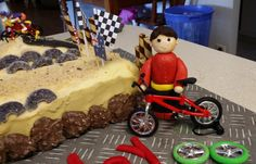 Deegan's 4th Birthday cake - BMX track. FYI the track is chocolate chip and tiny teddy biscuits. The fondant character was made to look like Deegs