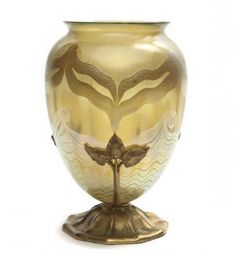 A Tiffany Studios Favrile Glass and Gilt Bronze Mounted Vase,the glass of amphora form with gilt decoration, the base. Tiffany Art, Tiffany Glass, Tiffany And Co, Louis Comfort Tiffany, Stained Glass Lamps, Art Studios, Art Nouveau, Glass Art, Bronze