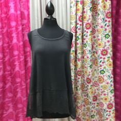 Ash gray racerback tank...so versatile!! Can be worn as an extender or pair with one of our tube tops or wear alone...PERFECT! Gorgeous lace hem. 65% cotton 35% polyester