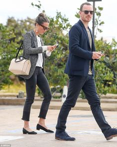 Trendy: The Tomb Raider actress, 29, cut a conventionally chic figure in a monochromatic blazer as she enjoyed an intimate stroll with her dapper husband, 40