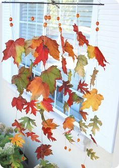 Whimsical Autumn Leaves Windcatcher: designed as a child craft, but really cute from centsationalgirl.com