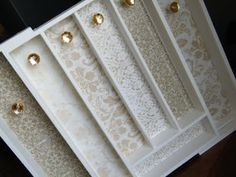 Jewelry organizer using a cutlery tray, scrapbook paper, mod podge and small/decorative knobs. Super cute!