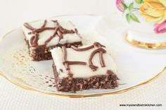 This easy-to-make unbaked Chocolate Coconut Square is sure to appeal to any sweet tooth and makes a fine addition to sweet trays Icing Ingredients, Chocolate Squares, Icing Recipe, Unsweetened Cocoa, Bistro Kitchen, Dessert Bars, Cookie Recipes, Sweet Tooth, Coconut