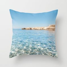 Throw Pillow made from 100% spun polyester poplin fabric, a stylish statement that will liven up any room.Island, water, transparent, sea, reflection, beach, sand, pebbles, blue, summer, photo, photography, photograph, pic, art, photo art, photo print, art print, wall art, frame, tapestry, interior design, wall decor, decoration, decoracao