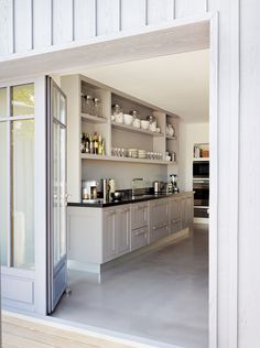 Smallbone of Devizes 'Brunet' contemporary hand painted living kitchen. Polished concrete flooring for a contemporary edge.