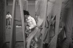 "Murakami Saburo, ""Passing Through,"" 1956. Performance views, ""2nd Gutai Art Exhibition,"" Ohara Kaikan, Tokyo, ca. October 11–17, 1956. Photo: Otsuji Seiko Collection, Musashino Art University Museum & Library, Tokyo. © Otsuji Seiko and Murakami Makiko. Photo: Otsuji Kiyoji."