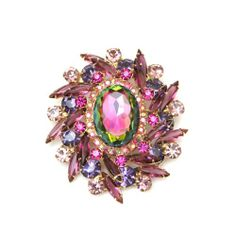 Stunning 1950's Juliana, purple and fushia rhinestone pin with large oval watermelon stone in center.  For price inquiry e-mail us at vintagecostumejewelry@caroletanenbaum.com  #vintagecostumejewerly #vintage #juliana #pin #jewelry #caroletanenbaum