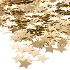 Gold star confetti....would go great with the Hollywood theme session....also just fun to toss