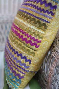 ric rac pillow - perhaps a fun way to use all that vintage ric rac from Mom :-)