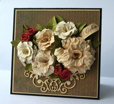 I LOVE the detail in these paper flowers made with the rose creations die by Spellbinders- I have to get that die! Maybe my Tim H die will work.
