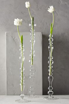 Delicate glass bubble vases from Anthropologie. So pretty with a single stem in each case!