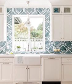 When your pretty tile dreams come true.😍🌊🙌🏻 Such a beautiful white kitchen with blue tile backsplash - Coastal perfection! Blue Tile Backsplash Kitchen, Backsplash For White Cabinets, Blue Kitchen Cabinets, Kitchen Redo, Kitchen Design, Kitchen Ideas, Backsplash Ideas, Beach House Kitchens, Cottage Kitchens