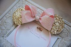 Oh my! These gold glitter Minnie Mouse Ears will make a chic statement for your little lady! Adorned with a sparkly pink bow with a rhinestone buckle center. So fancy! Perfect accessory for a birthday party or simply a trip to Disney any time of the year! Recommended for ages 12