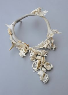 Jennifer Trask, Germinate Necklace, 2010. Bone, antler, teeth, pre-ban ivory, steel, brass, diamonds.