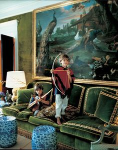 Francois Halard - Vogue Living - Tory Burch's sons Nick and Henry play on a silk sofa designed by Daniel Romualdez in homage to Givenchy in the living room of their New York apartment. The 17th-century Dutch farmyard painting is by Jacobus Victors.