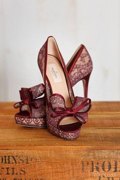 Lace red peep toe shoes with bow.
