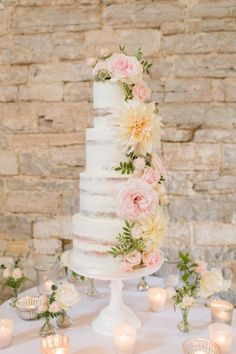 Siobhan and Tom's charming Somerset wedding captured by Bowtie adn Bellle at the picturesque Almonry Barn. With a palette of tender blush pinks and elegant creams, their wedding is oh so pretty and cheerful! We have fallen head over heels in love with their wedding cake by Edible Essence adorned with flowers, and the stunning floral design created by Amber Persia!