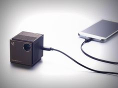 This little cube is the smallest 720p laser projector in the world! It sits right in your hand, giving you the feeling of wielding something rather