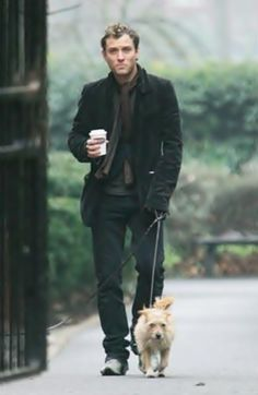 Jude Law with coffee and a dog