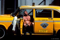 Jay Maisel - the colourless background emphasises the yellow of the taxi; a warm colour to reflect the heat of the day