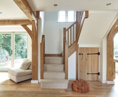 oak staircase with carpet and oak cupboard door
