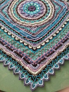 A beautiful tablecloth approximately 90cm x 90cm when crocheted with Alize Diva and hook 3 mm. You will need 8 skeins of this yarn.