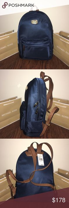 """MICHAEL KORS Jet Set Lg Back Pack Navy Guaranteed Authentic! Michael Kors jet set large backpack in navy blue and gold tone hardware. Water nylon fabric, and adjustable straps in acorn brown saffiano leather. Approx. measurements: 16""""H x 11""""L x 5.5""""W. Interior fabric lining with MK logo, one zipper pocket and 5 slid pockets. One exterior front zipper pocket. Item will be videotaped prior to shipping to ensure proof of condition. Michael Kors Bags Backpacks"""